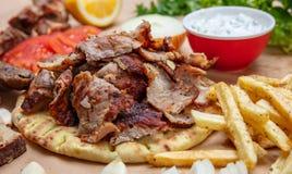 Shawarma, gyros pita. Traditional turkish, greek meat food on pita bread. Closeup view royalty free stock photos