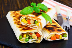Shawarma Lavash with Rice and Vegetables. Studio Photo stock photography