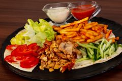 Shawarma in the plate. Shawarma with meat in the plate stock photography