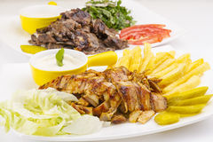 Shawarma Plate , Shawarma beef and chicken plate. Served with fries tomato Tahini and parsley stock images
