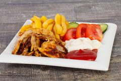 Shawarma in plate. With fried potato royalty free stock photo