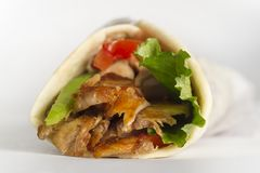 Shawarma sandwich, Doner Kebab. Arabic, Greek or Turkish sandwich with meat on white background Stock Images