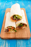 Shawarma sandwich - fresh roll of thin lavash pita bread filled with grilled meat Royalty Free Stock Photography