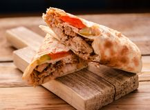 Shawarma sandwich gyro fresh roll of lavash pita bread chicken beef shawarma falafel RecipeTin Eatsfilled with grilled. Meat, mushrooms, cheese. Traditional stock photo