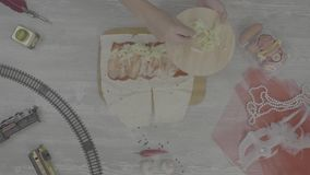 Shawarma sandwich with ingredients on white background. Top view. Cooking homemade doner, raw chicken, vegetables stock footage