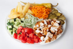 Shawarma still life on a plate meat chicken cabbage carrot onion pepper Royalty Free Stock Photo
