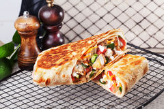 Shawarma still life on a plate meat chicken cabbage carrot onion pepper thin lavash Stock Images
