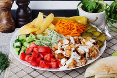 Shawarma still life on a plate top of meat chicken cabbage carrot onion pepper durum Royalty Free Stock Photo