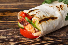 Shawarma. Traditional shawarma wrap with chicken and vegetables stock images