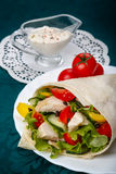 Shawarma on a white plate with a white sauce Stock Image