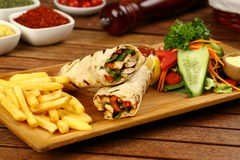 Shawarma wrap with chicken, fries and pickles. Shawarma with meat and vegetables wrapped in pita bread stock photos