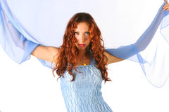 Shawl. Curly-headed girl with blue shawl Royalty Free Stock Photo