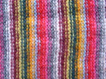 Shawl. Detail of hand made warm woolen striped shawl Stock Photo