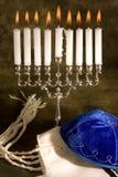 Shawl cap and menorah. Hanukkah candle-holder, prayer shawl and cap