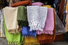 Shawls. Traditional style colourful shawls at market stall Stock Photo