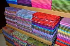 Shawls. Colorful fabrics on the show floor Stock Photos