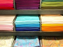 Shawls of different colors in the store royalty free stock photos
