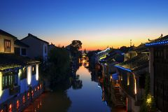 Aicent town of Jiangsu China, shaxi. Shaxi, an aicent town in Suzhou Jiangsu China. Image was shooted after sunset, on a bridge over a river. The buildings in stock images