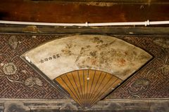 Details of a decoration folding fan in an ancient house in Shaxi village, Yunnan, China royalty free stock photography