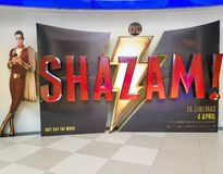 Shazam movie poster, this movie is about a kid can turn into the adult superhero Shazam stock image