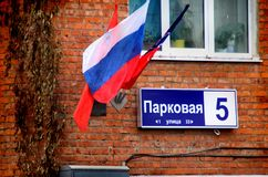Shchyolkovo. Flags of Russia, the Moscow region and the city of Shchyolkovo on the corner of house number 5 on Parkovaya street. Stock Images