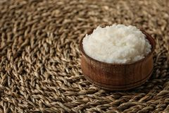 Shea butter in bowl on wicker mat, closeup. Space for text royalty free stock images