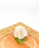 Shea butter lying on the wooden board, stands on the straw mat,. Unrefined, organic Shea butter with green leaves laying on the wooden board which is laying on Stock Photo