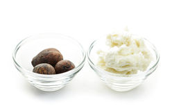Shea butter and nuts in bowls Stock Photo