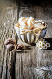 Shea butter and nuts. Cup of shea butter with shea nuts on wood Royalty Free Stock Image