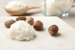 Shea butter and nuts on marble board. Space for text. Shea butter and nuts on marble board, closeup. Space for text stock photos