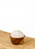 Shea butter in the wooden bowl stands on the straw mat, clean wh Stock Images