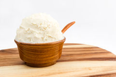 Shea butter in the wooden bowl stands on the wooden board, clean Stock Photo