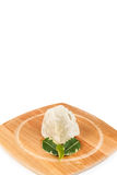 Shea butter in the wooden bowl stands on the wooden board, on th Royalty Free Stock Image