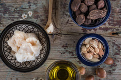 Shea nuts anbutter and argan oil and seeds Stock Photo