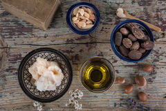Shea nuts anbutter and argan oil and seeds Royalty Free Stock Photos