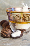 Shea nuts and butter. A glass of shea butter for skincare and shea nuts Royalty Free Stock Image