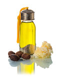 Shea nuts with oill and butter. Sea nuts with shea oil and shea butter, used in cosmetics. White background Stock Image