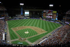 Shea Stadium - Night Game. A doomed Shea Stadium with its replacement in the shadows Royalty Free Stock Photo