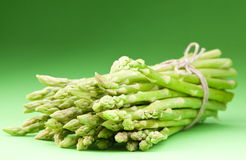 Sheaf of asparagus. On a green background Stock Photography