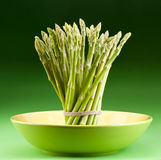 Sheaf of asparagus on a green. Stock Photo