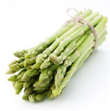 Sheaf of asparagus on a white background. Royalty Free Stock Photo