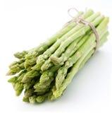 Sheaf of asparagus on a white background. Sheaf of asparagus lays on a white background Royalty Free Stock Photo