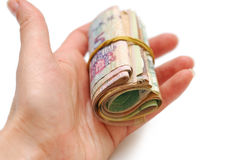 Sheaf of banknotes in woman hand. On white background Royalty Free Stock Images