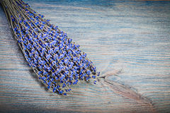 Sheaf of dry violet scented lavender on wooden board healthcare Royalty Free Stock Images