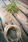 Sheaf of hay on a wooden background. Stock Photos