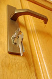 The sheaf of keys is inserted into a keyhole Stock Photos
