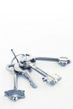 Sheaf of keys on a nail. Sheaf of keys  on white background Stock Photo