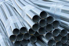 Sheaf of ribbed pipes. Close up of sheaves of metal ribbed pipes Stock Images