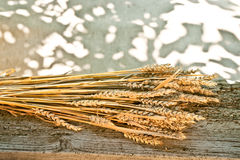 Sheaf of wheat. On the old desk Royalty Free Stock Images