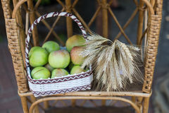 Sheaf of wheat. Green apples Stock Image